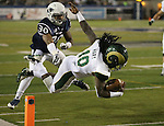Colorado State's Dee Hart (10) dives past Nevada's Tere Calloway (30) into the end zone during the second half of an NCAA college football game in Reno, Nev., on Saturday, Oct. 11, 2014. (AP Photo/Cathleen Allison)