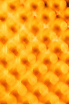 Creative yellow abstract of cheese grater holes