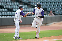 Trey Michalczewski (8) of the Winston-Salem Dash bumps fists with third base coach Tim Esmay (10) after hitting a 2-run home run in the bottom of the first inning against the Myrtle Beach Pelicans in game one of the Carolina League Southern Division Championship series at BB&T Ballpark on September 9, 2015 in Winston-Salem, North Carolina.  (Brian Westerholt/Four Seam Images)