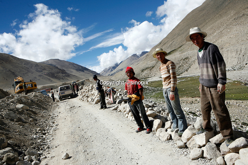 "China started building a controversial 67-mile ""paved highway fenced with undulating guardrails"" to Mount Qomolangma, known in the west as Mount Everest, to help facilitate next year's Olympic Games torch relay."