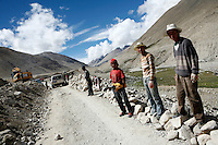 """China started building a controversial 67-mile """"paved highway fenced with undulating guardrails"""" to Mount Qomolangma, known in the west as Mount Everest, to help facilitate next year's Olympic Games torch relay."""