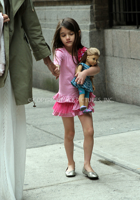 WWW.ACEPIXS.COM . . . . .  ....April 18 2012, New York City....Actress Katie Holmes and her daughter Suri Cuise return to their East Village apartment on Suri's 6th birthday on April 18 2012 in New York City....Please byline: NANCY RIVERA- ACEPIXS.COM.... *** ***..Ace Pictures, Inc:  ..Tel: 646 769 0430..e-mail: info@acepixs.com..web: http://www.acepixs.com
