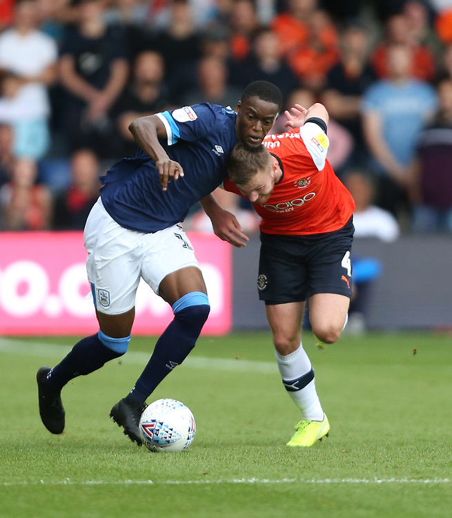 Huddersfield Town's Adama Diakhaby and Luton Town's Ryan Tunnicliffe<br /> <br /> Photographer Rob Newell/CameraSport<br /> <br /> The EFL Sky Bet Championship - Luton Town v Huddersfield Town - Saturday 31 August 2019 - Kenilworth Stadium - Luton<br /> <br /> World Copyright © 2019 CameraSport. All rights reserved. 43 Linden Ave. Countesthorpe. Leicester. England. LE8 5PG - Tel: +44 (0) 116 277 4147 - admin@camerasport.com - www.camerasport.com