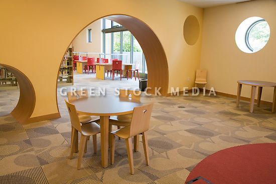 A view of the children's section of the library with a swiss cheese design. The San Mateo Public Library integrates significant green building practices and achieved LEED Silver certification. Green features include extensive daylighting, efficient underfloor air supply, venting windows, low VOC materials, native plant landscaping, and much more. San Mateo, California, USA