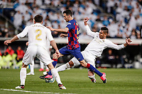 1st March 2020; Estadio Santiago Bernabeu, Madrid, Spain; La Liga Football, Real Madrid versus Club de Futbol Barcelona; Carlos Enrique Casemiro (Real Madrid) stabs the ball away from Sergio Busquets