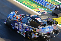 Aug 15, 2014; Brainerd, MN, USA; Crew chicf Mike Neff (left) directs NHRA funny car driver Robert Hight into the staging beams during qualifying for the Lucas Oil Nationals at Brainerd International Raceway. Mandatory Credit: Mark J. Rebilas-