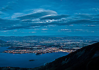 Lake Wanaka and its township as seen from Roys Peak at night, Central Otago, New Zealand