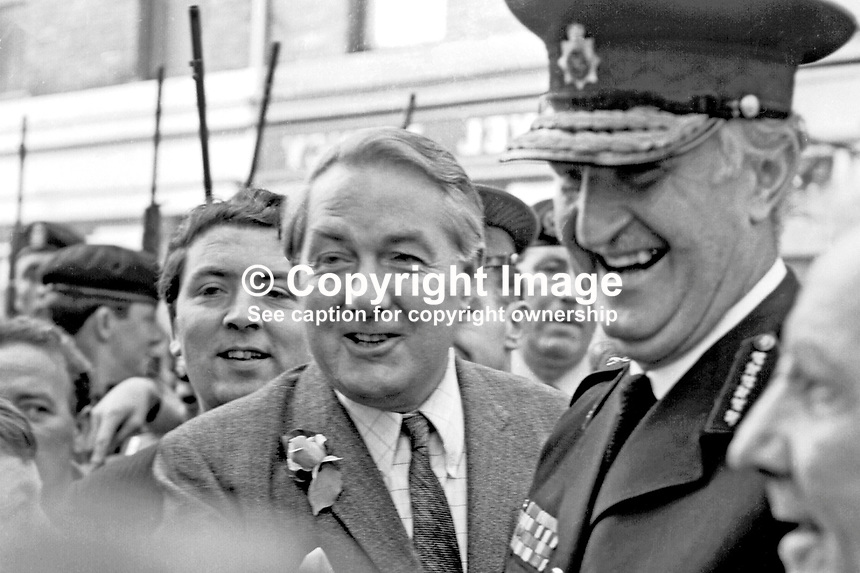 James Callaghan, UK Home Secretary, accompanied by John Hume, Derry Citizens' Action Committee, at his shoulder, and Sir Arthur Young, Commisioner of the City of London Police, who was later appointed Chief Constable of the RUC, at the start of their walkabout in the Bogside to meet local residents. 196908270002<br />