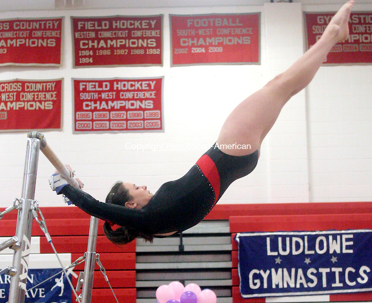 SOUTHBURY, CT 27 FEBRUARY 2010 - 0227JW14.jpg --  Pomperaug gymnastics team member Jaclyn Goulet competes on the Uneven Bars Saturday morning during the Class M Team Divisional Championship. Jonathan Wilcox Republican-American