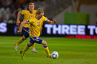 Sweden's Christian Wilhelmsson (front) and Oscar Wendt (back) lead the ball during the UEFA EURO 2012 Group E qualifier Hungary playing against Sweden in Budapest, Hungary on September 02, 2011. ATTILA VOLGYI