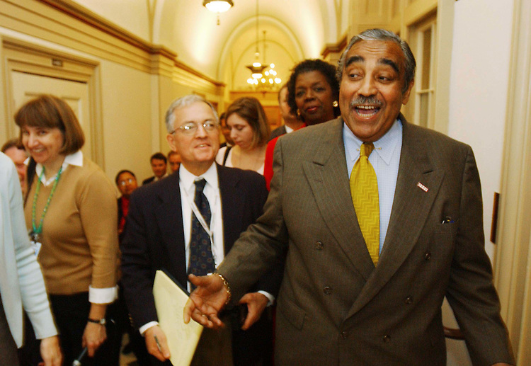 10/30/03.MEDICARE CONFERENCE--House ranking Democrat Charles B. Rangel, D-N.Y., followed by other Democrats and a swarm of reporters, leaves the hall where Chairman Bill Thomas, R-Calif., hosts the Medicare conference in his hideaway. Thomas would not allow Rangel, who is a member of the conference, and others to attend, even though at least two Democratic senators are regular participants in negotiations. Stephanie Tubbs Jones, D-Ohio, is behind Rangel..CONGRESSIONAL QUARTERLY PHOTO BY SCOTT J. FERRELL