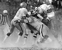 Oakland Raiders George Atkinson, Tony Cline and Ben Davidson mob Baltimore Colt #36. (photo by Ron Riesterer)