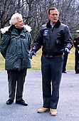 United States President George H.W. Bush and first lady Barbara Bush await the arrival of Chancellor Helmut Kohl of West Germany and his wife to Camp David, the presidential retreat near Thurmont, Maryland on February 24, 1990.<br /> Credit: Ron Sachs / CNP