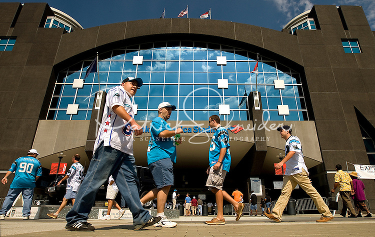 09/16/07 :  Carolina Panthers fans head to the Bank of America stadium during the Panthers' 2007 season opener against the Houston Texans.  ...The Carolina Panthers, professional American NFL football team that represents both North Carolina and South Carolina, is based in Charlotte, North Carolina. The Panthers began playing in 1995 as part of the National Football League?s expansion program. They are members of the National Football Conference (NFC) South Division. They play in the Bank of America Stadium, located in downtown Charlotte.