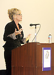 Erin Brockovich speaking at a WomanSage event in 2006.