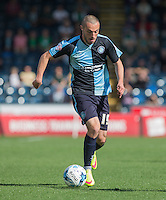 Michael Harriman of Wycombe Wanderers in action during the Sky Bet League 2 match between Wycombe Wanderers and Plymouth Argyle at Adams Park, High Wycombe, England on 12 September 2015. Photo by Andy Rowland.