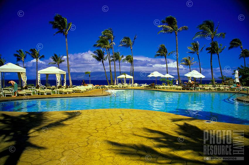 palm trees, cabanas and swimming pool at Kapalua Bay Hotel, Kapalua, Maui