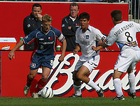 New England's Joe Franchino, left, San Jose's Brian Ching, right, San Jose vs. New England, Foxboro, Ma, May 3, 2003. San Jose won 2-0.