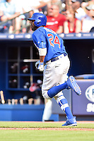 Chicago Cubs center fielder Dexter Fielder (24) runs to first during a game against the Atlanta Braves at Turner Field on June 11, 2016 in Atlanta, Georgia. The Cubs defeated the Braves 8-2. (Tony Farlow/Four Seam Images)