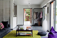 The glass front door opens straight into the open-plan living area
