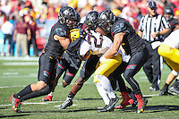 College Park, MD - October 15, 2016: Minnesota Golden Gophers running back Shannon Brooks (23) is tackled by several Maryland Terrapins defenders during game between Minnesota and Maryland at  Capital One Field at Maryland Stadium in College Park, MD.  (Photo by Elliott Brown/Media Images International)