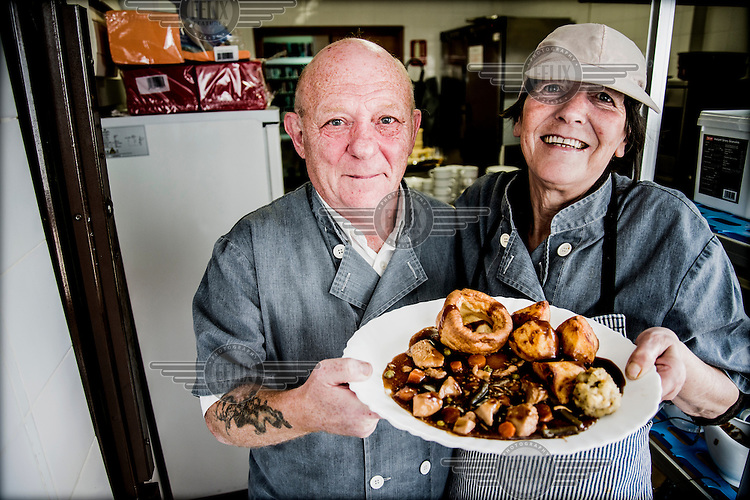 The cooks with a plate of food at the The English Speaking Club El Campello. Spain is home to more British ex-pats than anywhere else in the world, mostly concentrated in its Mediterranean regions and there are numerous clubs and organisations catering to this population. The English Speaking Club El Campello, whose president is former RAF and the vice-president a former policeman, organises raffles, dances, trips and games etc and has over 400 members.