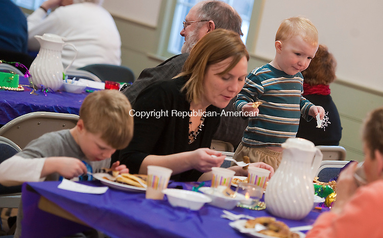 SOUTHBURY, CT-030414JS01--Kate Lowry of Southbury, center, enjoys a pancake dinner with her sons Joshua, 5, left, and Evan, 2, during the annual Shrove Tuesday pancake supper Tuesday at the South Britain Congregational Church in Southbury. Jim Shannon Republican-American