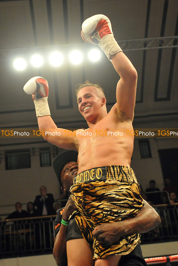 Romeo Romaeo (camouflage shorts) defeats Michael Mooney - Boxing at York Hall, Bethnal Green, London - 27/03/15 - MANDATORY CREDIT: TGSPHOTO - Self billing applies where appropriate - contact@tgsphoto.co.uk - NO UNPAID USE