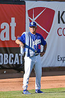 Ogden Raptors pitching coach Bobby Cuellar (26) before the game against the Idaho Falls Chukars in Pioneer League action at Lindquist Field on June 22, 2015 in Ogden, Utah. The Chukars defeated the Raptors 4-3 in 11 innings. (Stephen Smith/Four Seam Images)