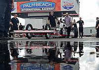 Jan. 16, 2013; Jupiter, FL, USA: Crew members move the car of NHRA top fuel dragster driver Steve Torrence during testing at the PRO Winter Warmup at Palm Beach International Raceway.  Mandatory Credit: Mark J. Rebilas-