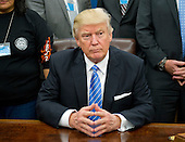 United States President Donald Trump poses for a group with American Labor leaders in the Oval Office of the White House in Washington, DC on Monday, January 23, 2017.<br /> Credit: Ron Sachs / Pool via CNP