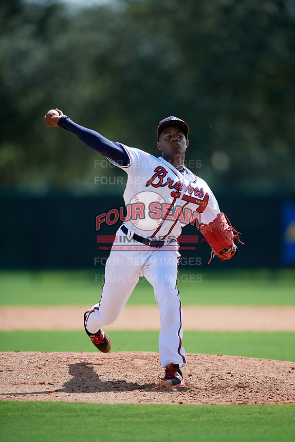 GCL Braves relief pitcher Alex Aquino (30) delivers a pitch during the first game of a doubleheader against the GCL Yankees West on July 30, 2018 at Champion Stadium in Kissimmee, Florida.  GCL Yankees West defeated GCL Braves 7-5.  (Mike Janes/Four Seam Images)