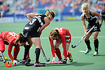 The Hague, Netherlands, June 02: Krystal Forgesson #3 of New Zealand battles for the ball with Hye Lyoung Han #9 of Korea and Okju Kim #17 of Korea during the field hockey group match (Group A) between Korea and New Zealand´s Black Sticks on June 2, 2014 during the World Cup 2014 at GreenFields Stadium in The Hague, Netherlands. Final score 1:0 (1:0) (Photo by Dirk Markgraf / www.265-images.com) *** Local caption ***
