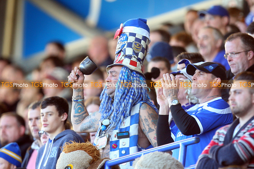 The Pompey bell ringer - Portsmouth vs Dagenham and Redbridge, Sky Bet Football League football at the Fratton Park Stadium - 26/12/13 - MANDATORY CREDIT: Dave Simpson/TGSPHOTO - Self billing applies where appropriate - 0845 094 6026 - contact@tgsphoto.co.uk - NO UNPAID USE