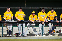 Members of the Canisius Golden Griffins watch the game against the Charlotte 49ers from the dugout at Hayes Stadium on February 23, 2014 in Charlotte, North Carolina.  The Golden Griffins defeated the 49ers 10-1.  (Brian Westerholt/Four Seam Images)