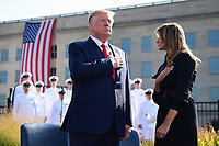 United States President Donald J. Trump and first lady Melania Trump salute the flag in front of the  Pentagon during the 18th anniversary commemoration ceremony of the September 11 terrorist attacks, in Arlington, Virginia on Wednesday, September 11, 2019.  <br /> Credit: Kevin Dietsch / Pool via CNP /MediaPunch