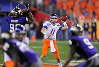 Jan. 4, 2010; Glendale, AZ, USA; Boise State Broncos quarterback (11) Kellen Moore throws a pass in the first quarter against the TCU Horned Frogs in the 2010 Fiesta Bowl at University of Phoenix Stadium. Mandatory Credit: Mark J. Rebilas-