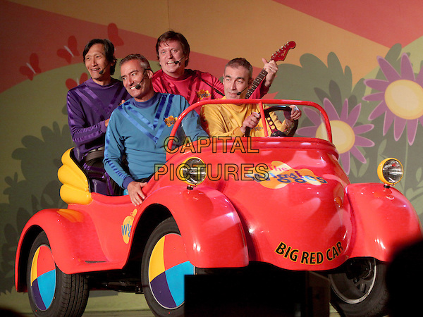 The Wiggles.Children's entertainment group The Wiggles made a stop at the historic Fox Theater in downtown Atlanta, where they played two sold-out shows packed with families who are fans of the Australian television performers.  The Wiggles have been together for 21 years, and this year three of the original members are retiring from the group.  This tour marks the last of the original members, Atlanta, GA., USA..July 31st, 2012.on stage performance performing full length purple yellow car blue top singing  .CAP/ADM/DH.©Dan Harr/AdMedia/Capital Pictures.