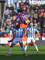 Manchester City's Leroy Sane out jumps Huddersfield Town's Juninho Bacuna<br /> <br /> Photographer Dave Howarth/CameraSport<br /> <br /> The Premier League - Huddersfield Town v Manchester City - Sunday 20th January 2019 - John Smith's Stadium - Huddersfield<br /> <br /> World Copyright © 2019 CameraSport. All rights reserved. 43 Linden Ave. Countesthorpe. Leicester. England. LE8 5PG - Tel: +44 (0) 116 277 4147 - admin@camerasport.com - www.camerasport.com