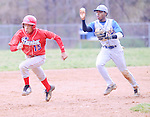 The Gazette Laurel shortstop Aychel Achi , right catches Friendly's Larry Green in a run-down during Laurel's 11-1 victory at Laurel on Monday afternoon.