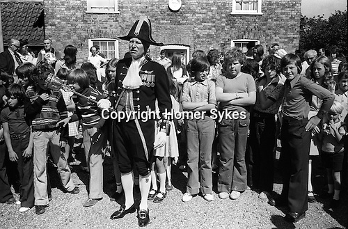 Sandwich Kent England 1975. August 24th St Bartholomew's Bun Race. The Bartlemas Bun Race. The Beadle prepares to start the race...