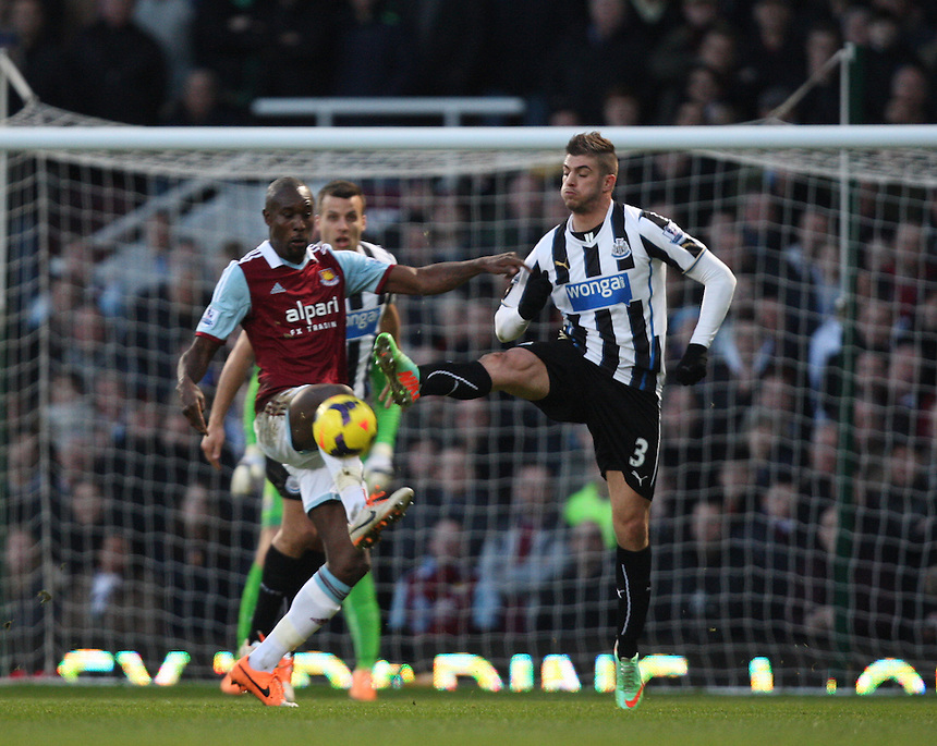 West Ham United's Carlton Cole despite the attentions of  Newcastle United's Davide Santon<br /> <br /> Photo by Kieran Galvin/CameraSport<br /> <br /> Football - Barclays Premiership - West Ham United v Newcastle United - Saturday 18th January 2014 - Boleyn Ground - London<br /> <br /> &copy; CameraSport - 43 Linden Ave. Countesthorpe. Leicester. England. LE8 5PG - Tel: +44 (0) 116 277 4147 - admin@camerasport.com - www.camerasport.com