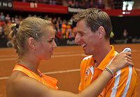 Netherlands, Den Bosch, April 18 2015 Maaspoort, Fedcup Netherlands-Australia,  Arantxa Rus (NED)  is celebrating with captain Paul Haarhuis Australia is eliminated<br /> Photo: Tennisimages/Henk Koster