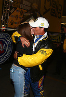 Nov 12, 2016; Pomona, CA, USA; NHRA funny car driver Ron Capps celebrates with family after clinching the 2016 funny car world championship during qualifying for the Auto Club Finals at Auto Club Raceway at Pomona. Mandatory Credit: Mark J. Rebilas-USA TODAY Sports