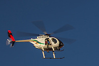 Police Helicopter on a search and rescue at Red Rock Canyon National Conservation Area outside of Las Vegas Nevada.