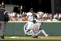 September 28, 2008: Seattle Mariners shortstop Yuniesky Bentancourt turns a double play during a game against the Oakland Athletics at Safeco Field in Seattle, Washington.