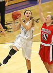 SIOUX FALLS, SD - DECEMBER 8:  Marie Malloy #4 from the University of Sioux Falls takes the ball to the basket past Alex Haley #20 from Minot State Friday night at the Stewart Center.(Photo by Dave Eggen/Inertia)