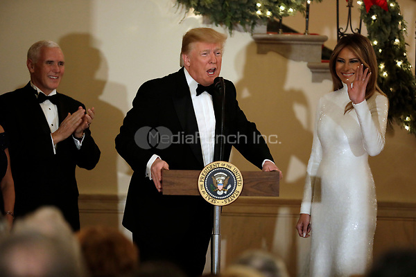 United States President Donald J. Trump makes remarks as First lady Melania Trump and US Vice President Mike Pence  look on at the Congressional Ball at White House in Washington, DC on December 15, 2018. <br /> Credit: Yuri Gripas / Pool via CNP / MediaPunch