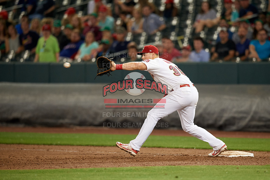 Memphis Redbirds first baseman Luke Voit (35) stretches to receive a throw during a game against the Round Rock Express on April 28, 2017 at AutoZone Park in Memphis, Tennessee.  Memphis defeated Round Rock 9-1.  (Mike Janes/Four Seam Images)