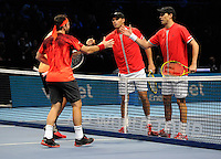 Rohan Bopanna (IND) / Florin Mergea (ROM) shake hands with Mike Bryan / Bob Bryan (USA) during Day One of the Barclays ATP World Tour Finals 2015 played at The O2, London on November 15th 2015